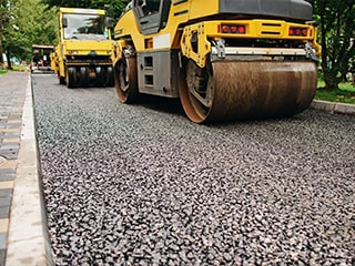 compressing road tarmac
